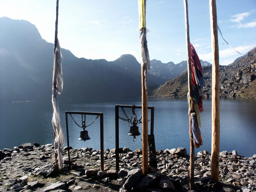 Prayer flags and ceremonial bells beside the shores of Gosainkund
