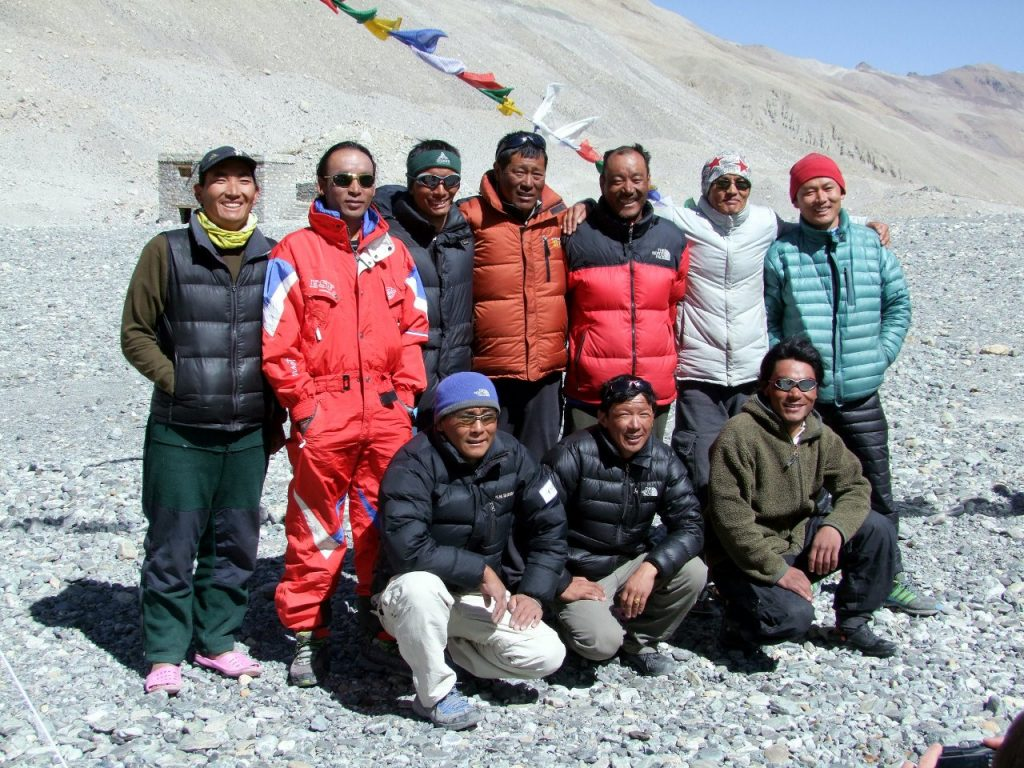 Our Sherpa team at Chinese Base Camp on Everest in 2012. Chongba is in the orange jacket in the middle of the back row.