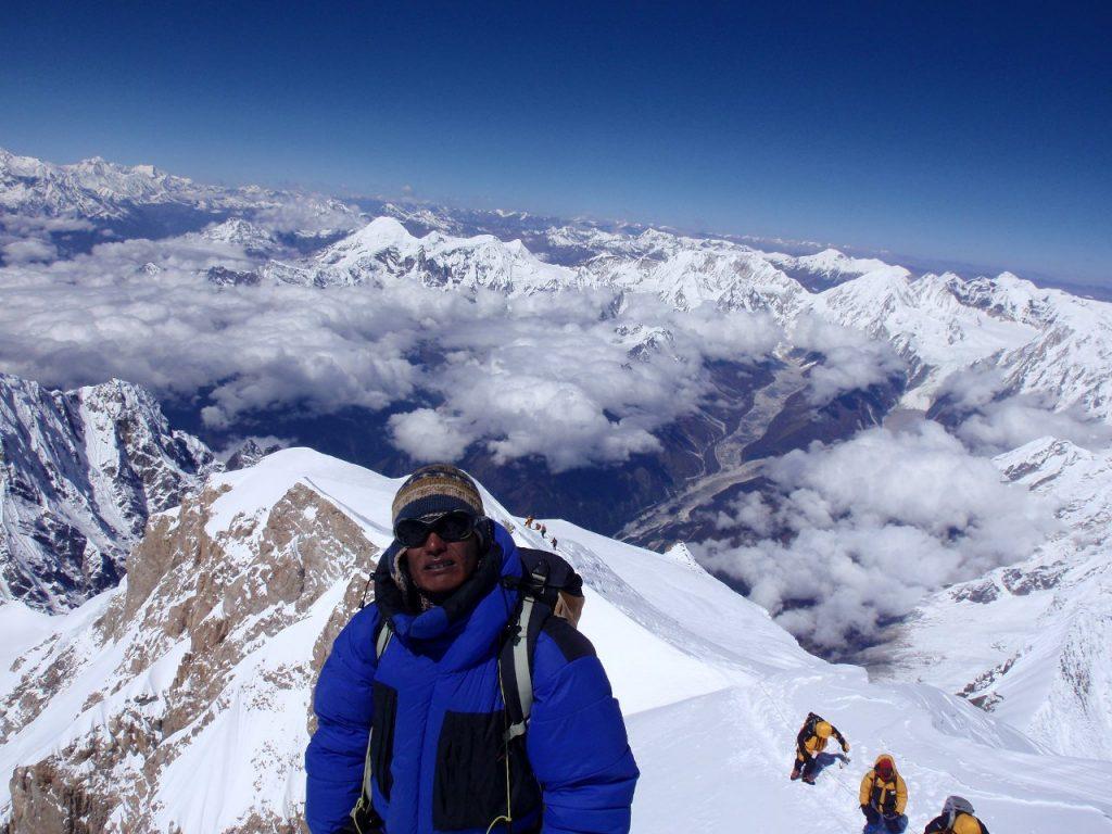 Chedar Sherpa on the summit of Manaslu, as Ian, Chongba and I approach below (Photo: Karel Masek)