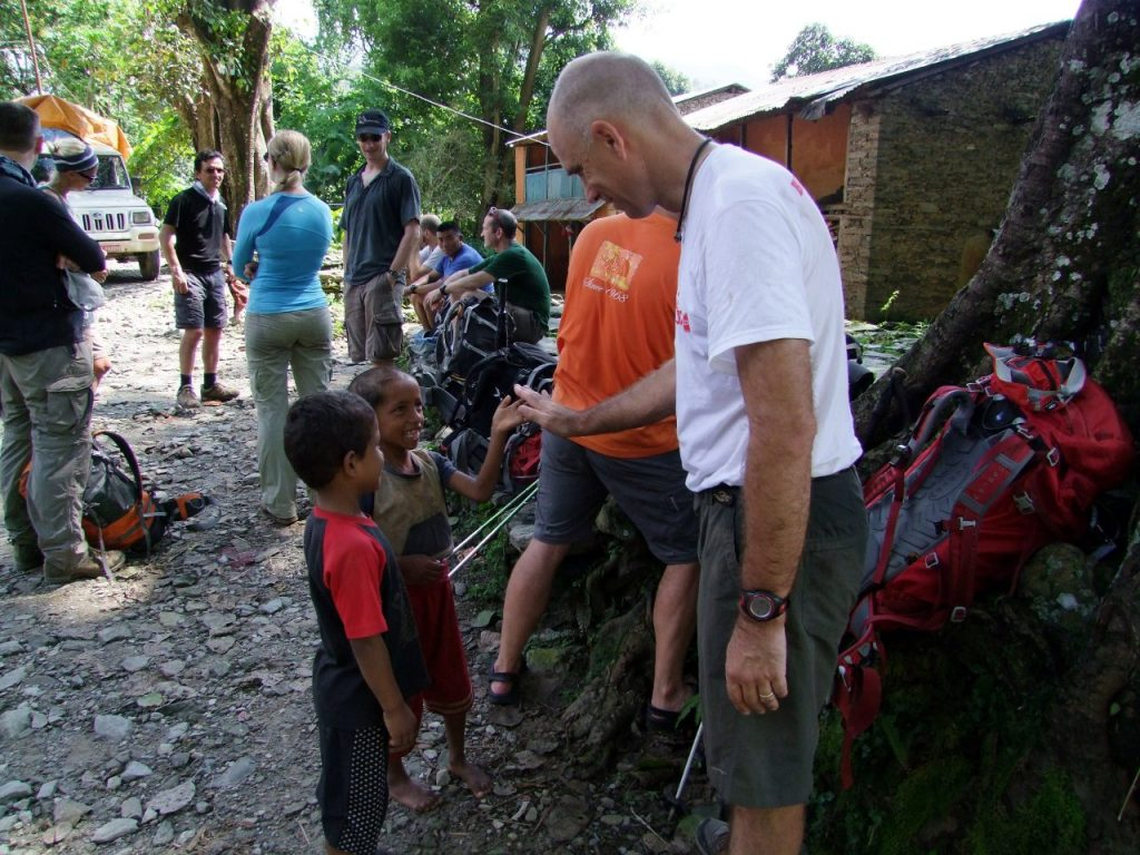 Robert Kay makes a couple of new friends in Arughat at the start of the Manaslu Circuit trek