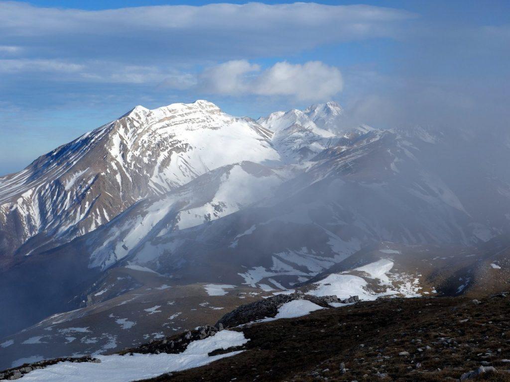 On the summit of Monte San Franco the clouds clear to reveal Gran Sasso's big three: Monte Corvo, Pizzo d'Intermesoli and Corno Grande