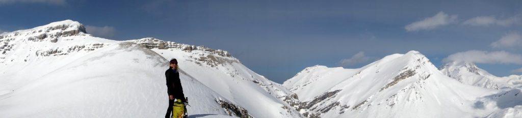 Edita on the summit of Cima Falasca, with the Gran Sasso big three behind her: Monte Corvo, Pizzo d'Intermesoli and Corno Grande