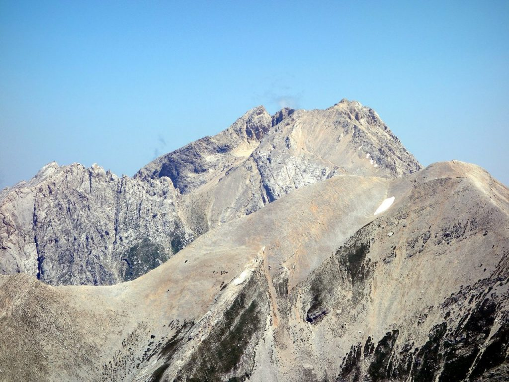 The high peaks of Gran Sasso - The Great Stone - Corno Piccolo (behind left), Corno Grande (behind right) and Pizzo d'Intermesoli (front) from the summit of Monte Corvo