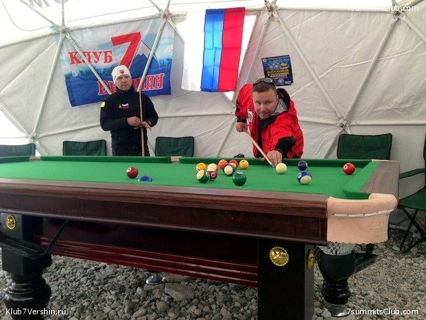 Members of the Russian 7 Summits Club expedition play pool in their dome tent at Everest Base Camp, Tibet (Photo: 7 Summits Club)