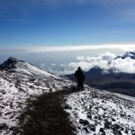 On Kilimanjaro's outer crater rim, with Mawenzi in cloud below