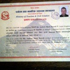 On summit certificates, liaison officers and funny mountaineering rules