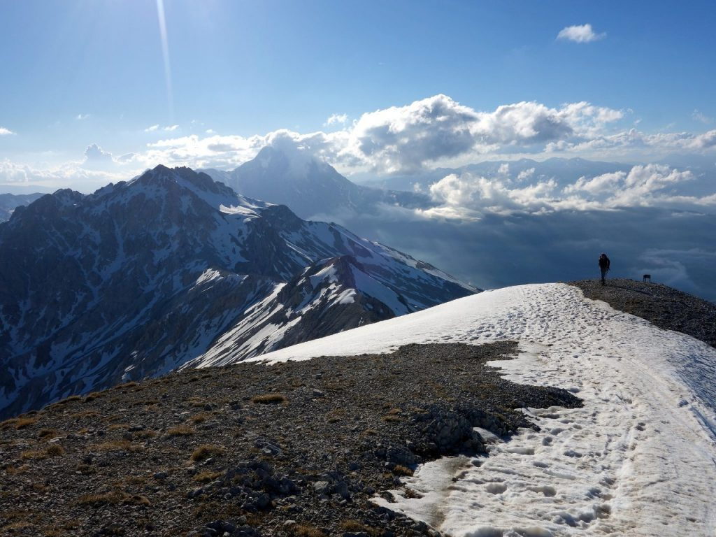 Approaching the summit of Monte Camicia, with Monte Prena along the ridge in the foreground, and Corno Grande in cloud behind