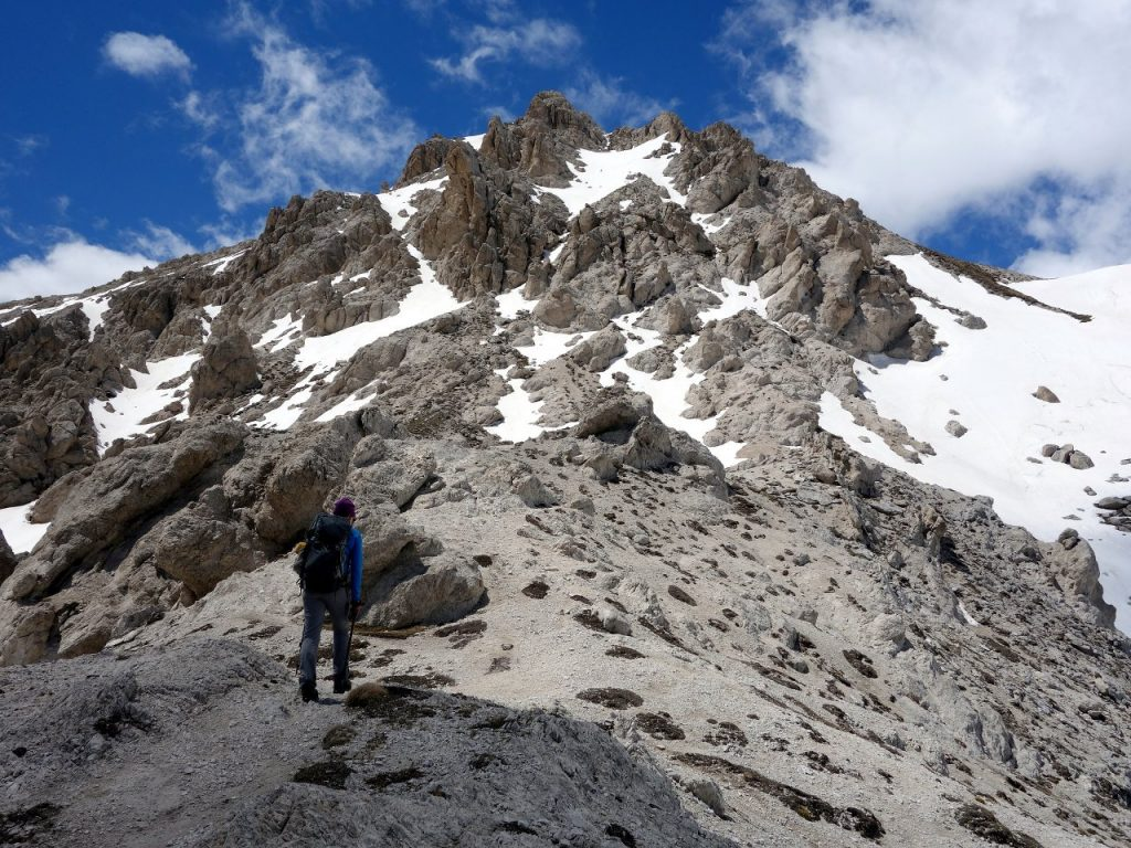 Approaching the rocky fortress of Monte Prena. We ascended the snow slope to the right.