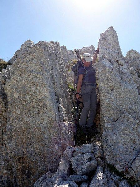 Edita scrambles down the subsidiary ridge to Monte Ninna