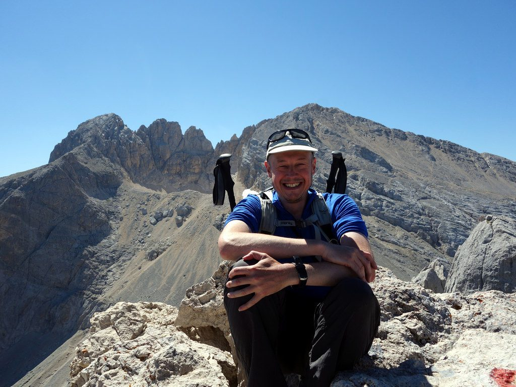 Me on the summit of Corno Piccolo, with the four summits of Corno Grande (Vetta Orientale, Vetta Centrale, Torrione Cambi, and the main summit Vetta Occidentale) behind