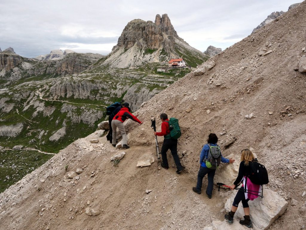 Hikers on a high trail between Rifugio Lavaredo and Rifugio Locatelli