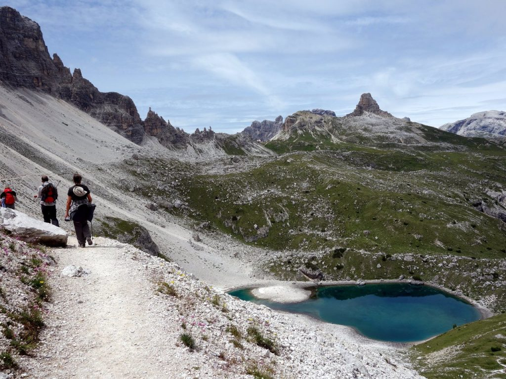 Walkers on the 101 trail, with Alpe dei Piani on the right