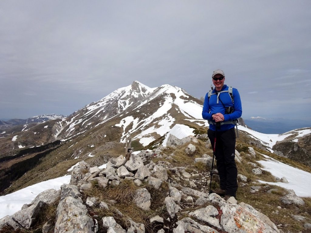 Me on the summit of Monte Siella, with Monte Tremoggia behind and Monte Camicia behind that