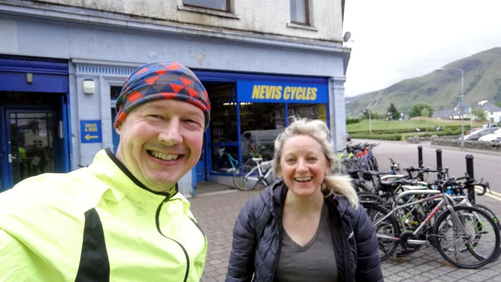Glad to get that one over with: Edita and I reach journey's end at Nevis Cycles in Fort William