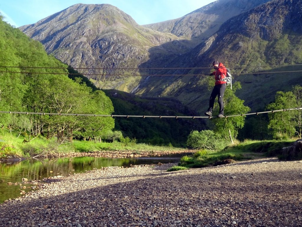 Crossing the infamous wire bridge over the Water of Nevis