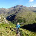 Edita makes her way up An Gearanach, with Ben Nevis rising behind