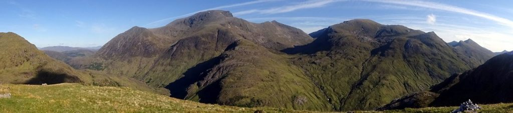 Panorama of Glen Nevis, Ben Nevis, Carn Mor Dearg and Aoneag Beag from a balcony on the way up An Gearanach