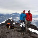 Edita and me on the summit of Tungurahua, with Chimborazo on the horizon, and the secondary summit and crater below