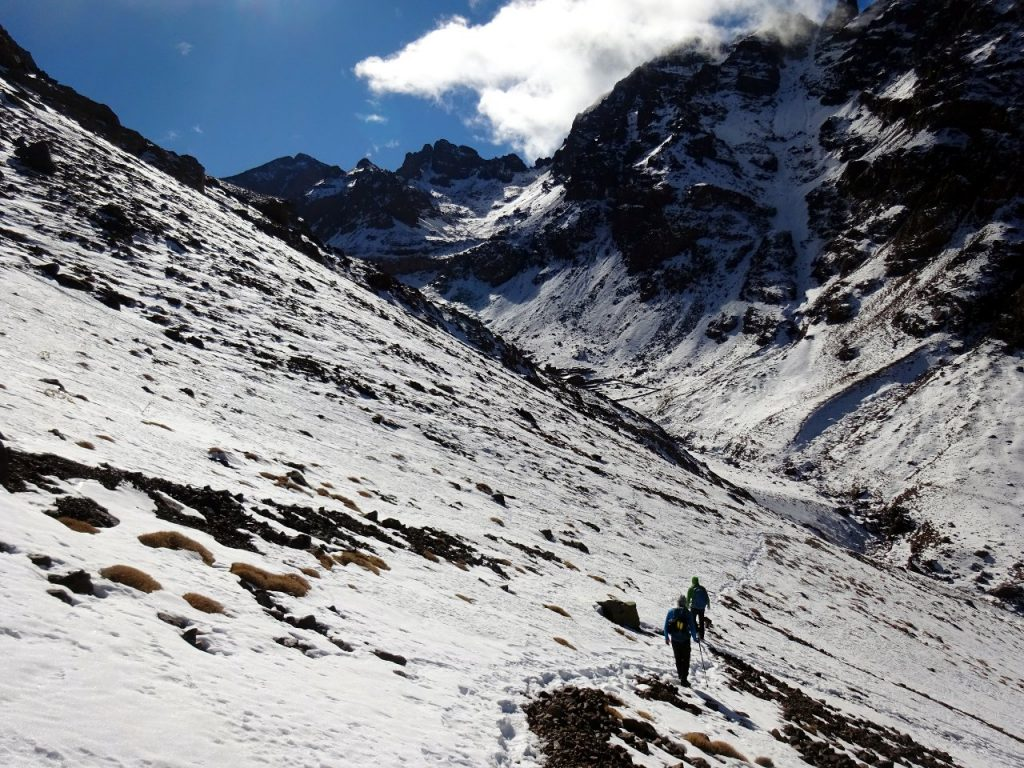 Descending Toubkal's north-west couloir, with Ras n-Ouanoukrim and Akioud up ahead