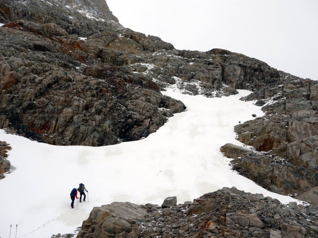 Crossing a patch of fresh snow between rock slabs on the second summit attempt