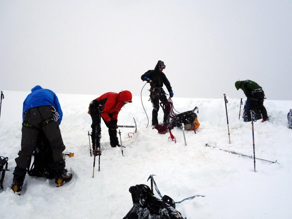 Abandoning camp below Brecha de la Cornisa during a blizzard