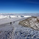 Walking the rim of the inner crater, with the Northern Icefield and a blanket of clouds below