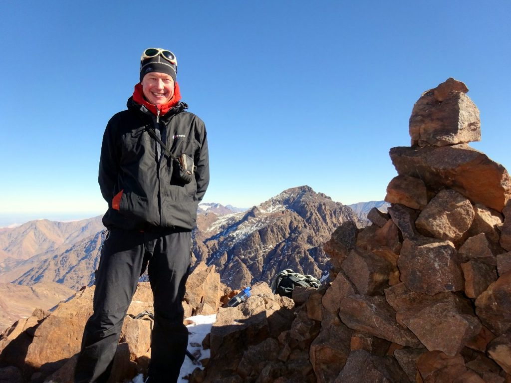 Me on the summit of Akioud, with Jebel Toubkal behind