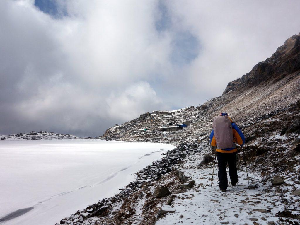 Walking beside the frozen lake at Gosainkund