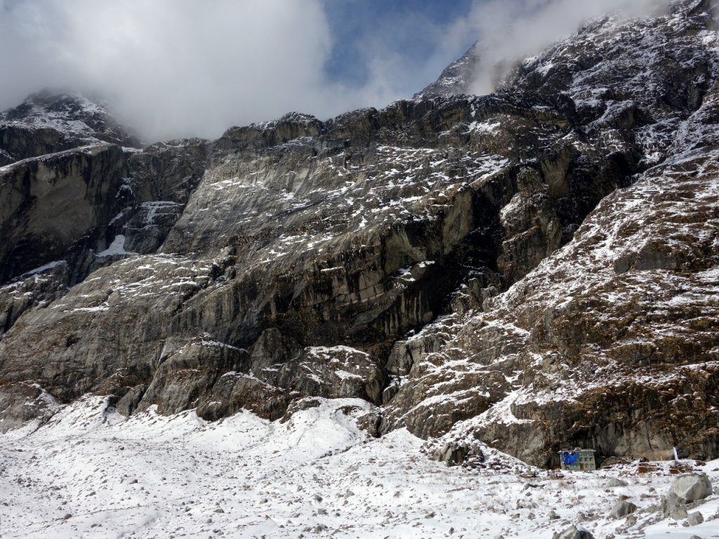 The remaining house in old Langtang village, and the couloir that funnelled the devastation