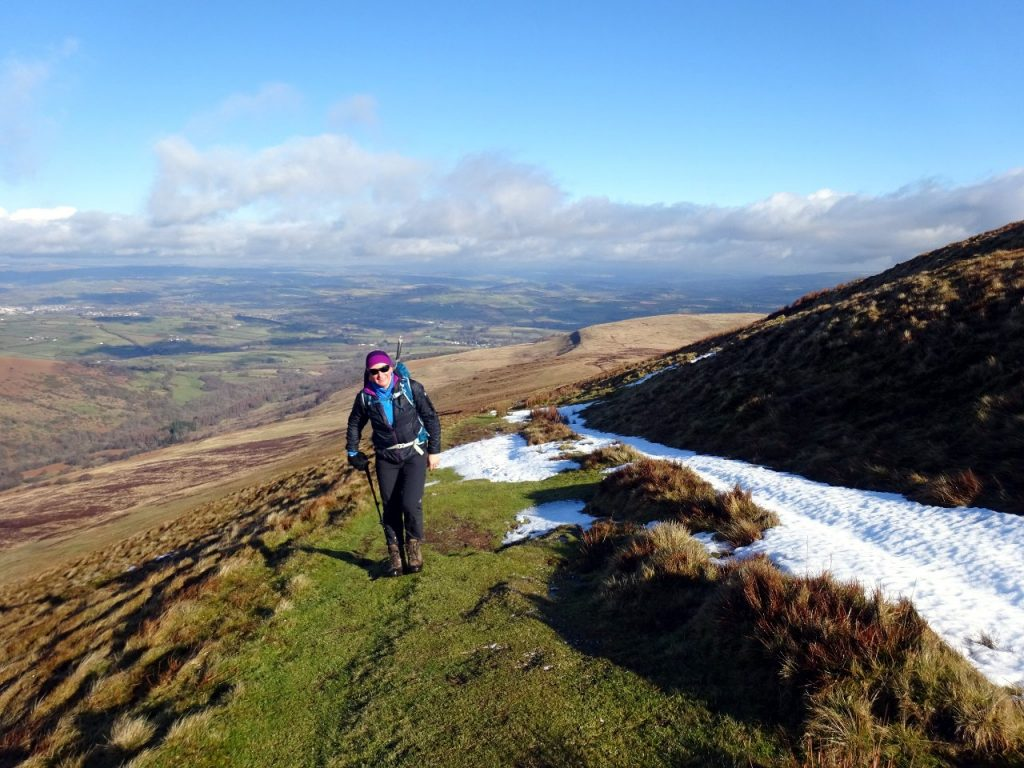 Edita ascends the Gist Wen ridge to the Pen y Fan escarpment