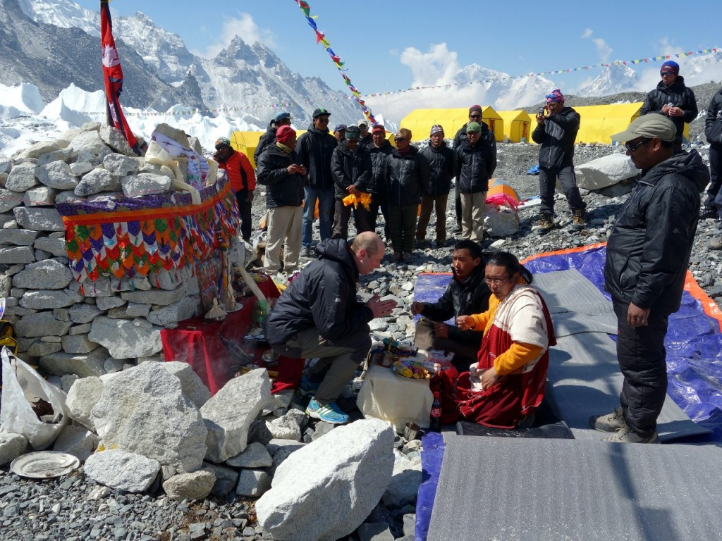 I accept a prayer book from the lama during our Base Camp puja ceremony