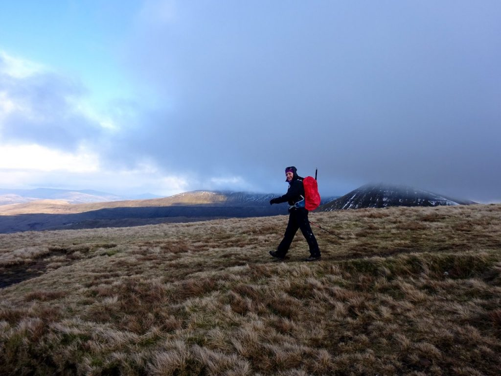 Edita descends Pen y Fan's northern ridge, with the three parallel ridges behind her