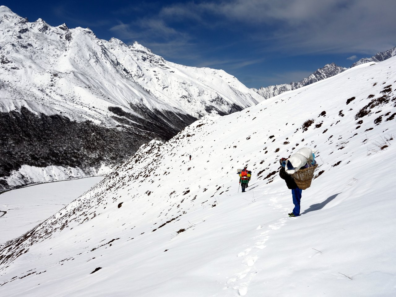 Porters traversing Tserko Ri on the way to Yala Peak base camp
