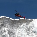 A helicopter flies over Everest Base Camp, but have climbers been chartering them to fly into the Western Cwm?