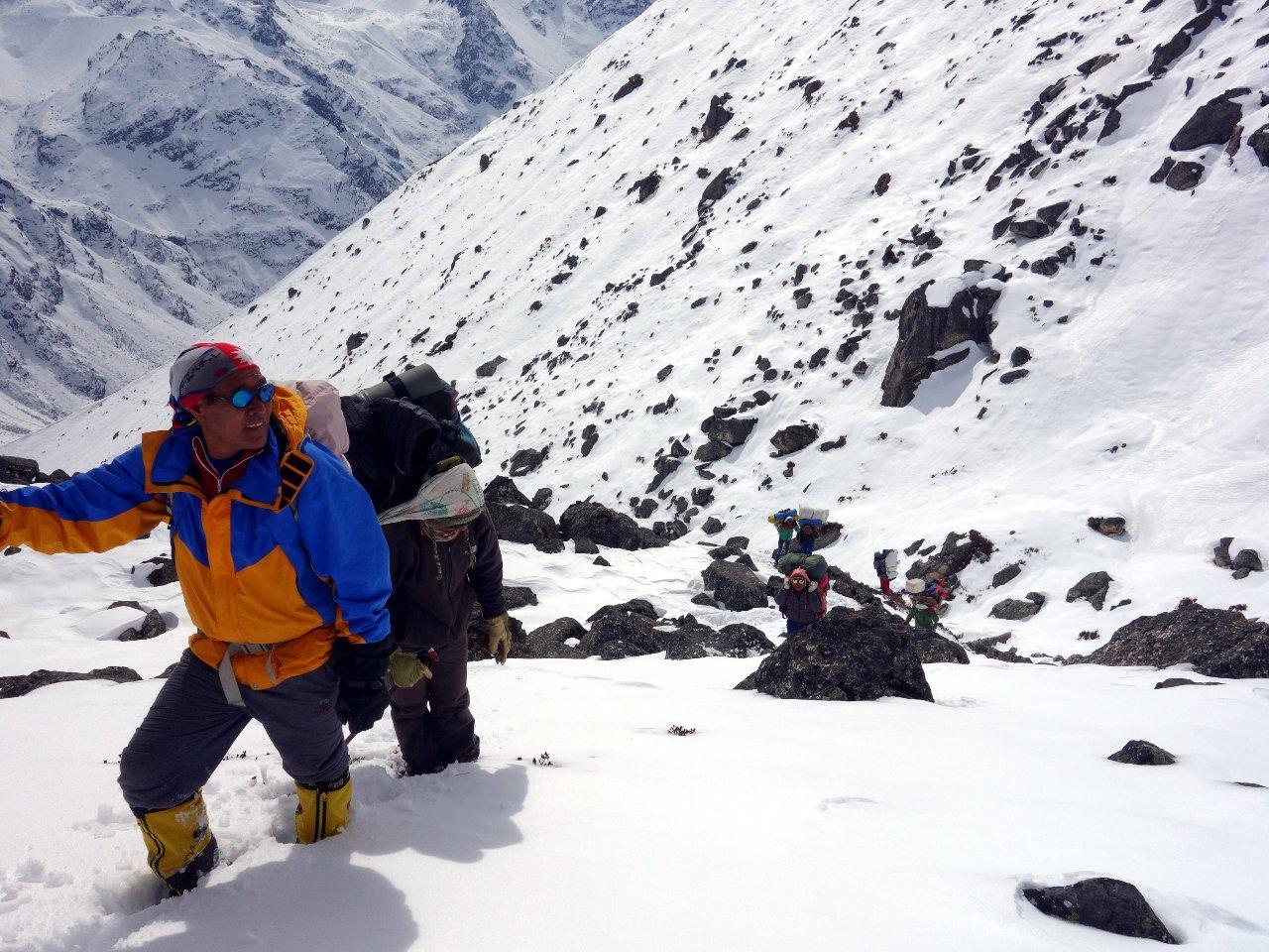 Trail breaking through deep snow on the way to Yala Peak base camp
