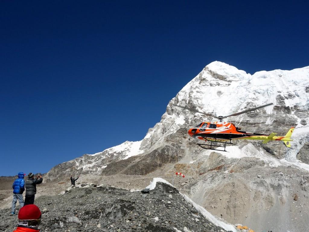 Helicopter arrives at Everest Base Camp