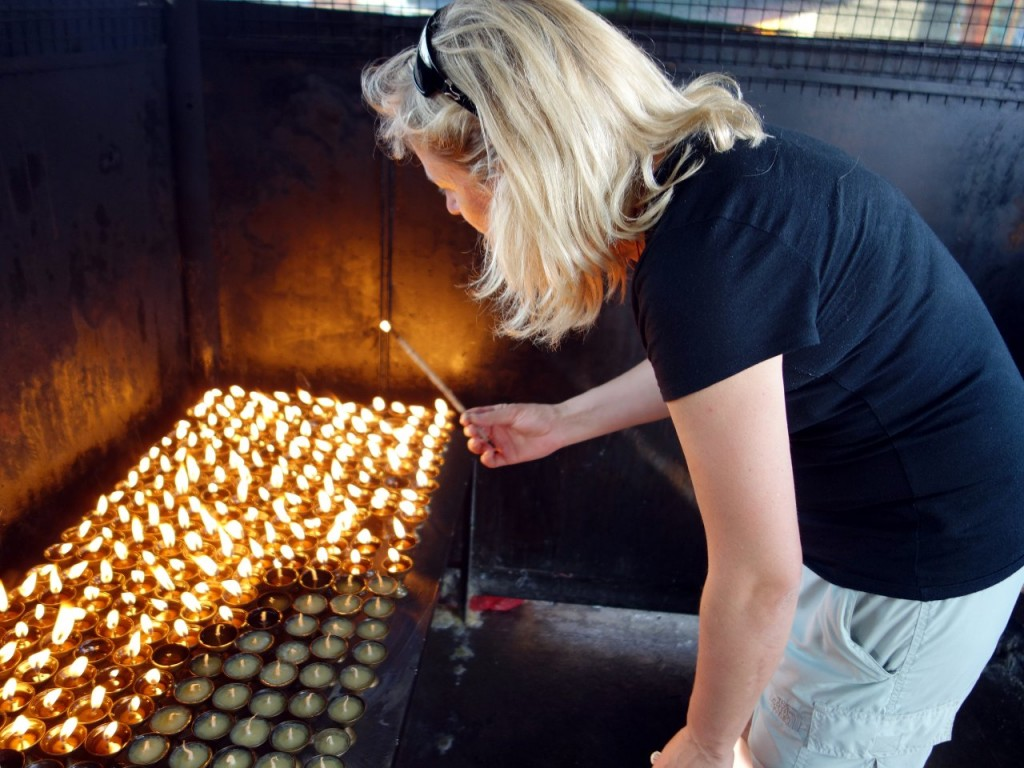 Back in Kathmandu Edita lights butter lamps for those who died in the April 18 avalanche