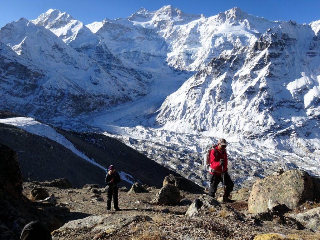 Trekking up Drohmo Ri, with the north face of Kangchenjunga over the left shoulder