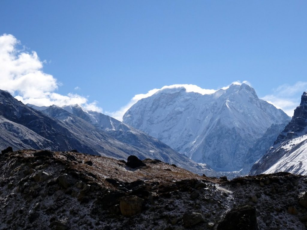 Nepal Peak (7,177m) from below Lhonak. Drohmo Ri (5,958m) is the little black pyramid on the left whose summit is just touching the skyline.