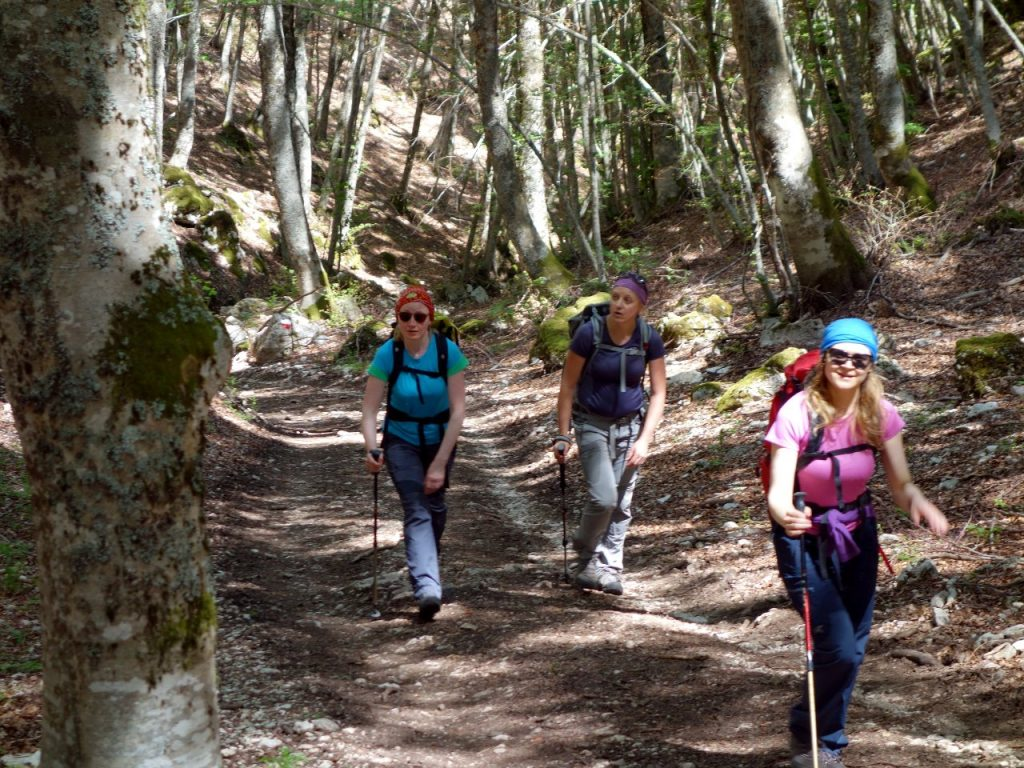 Jolanta, Edita and Bernadeta on the trail through forest on Monte Sirente