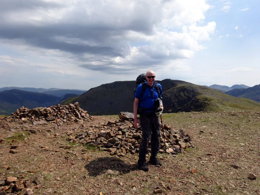 The hat's gone again: on the summit of Red Pike, with High Stile behind