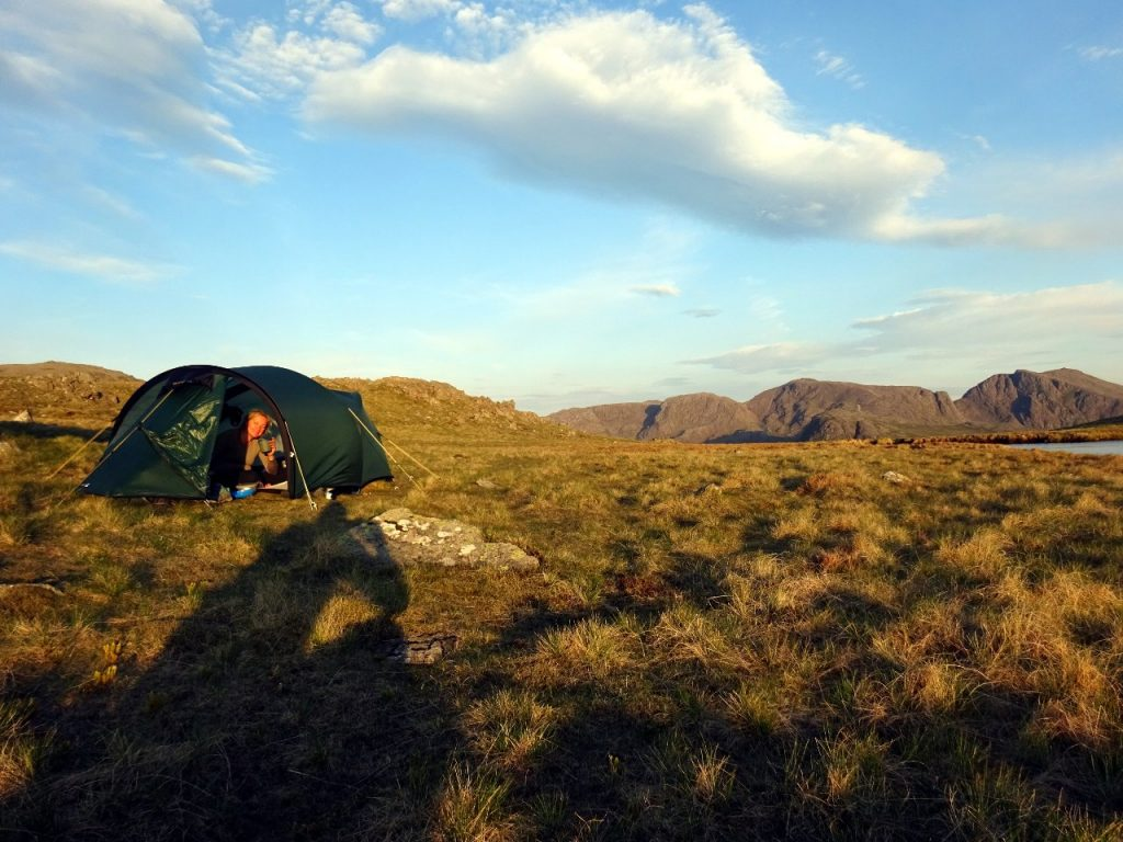 Edita looking happy at our wild camp on Kirk Fell, with Scafell Pike on the horizon