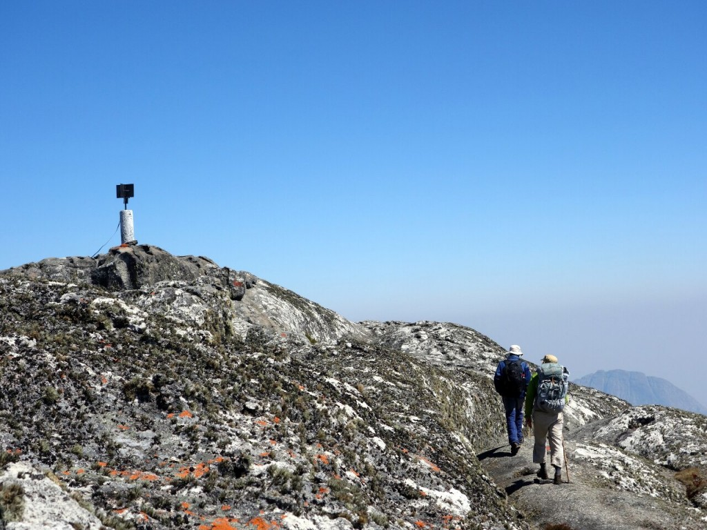 Approaching the concrete pillar on the summit of Sapitwa Peak (3002m), the highest point in Malawi