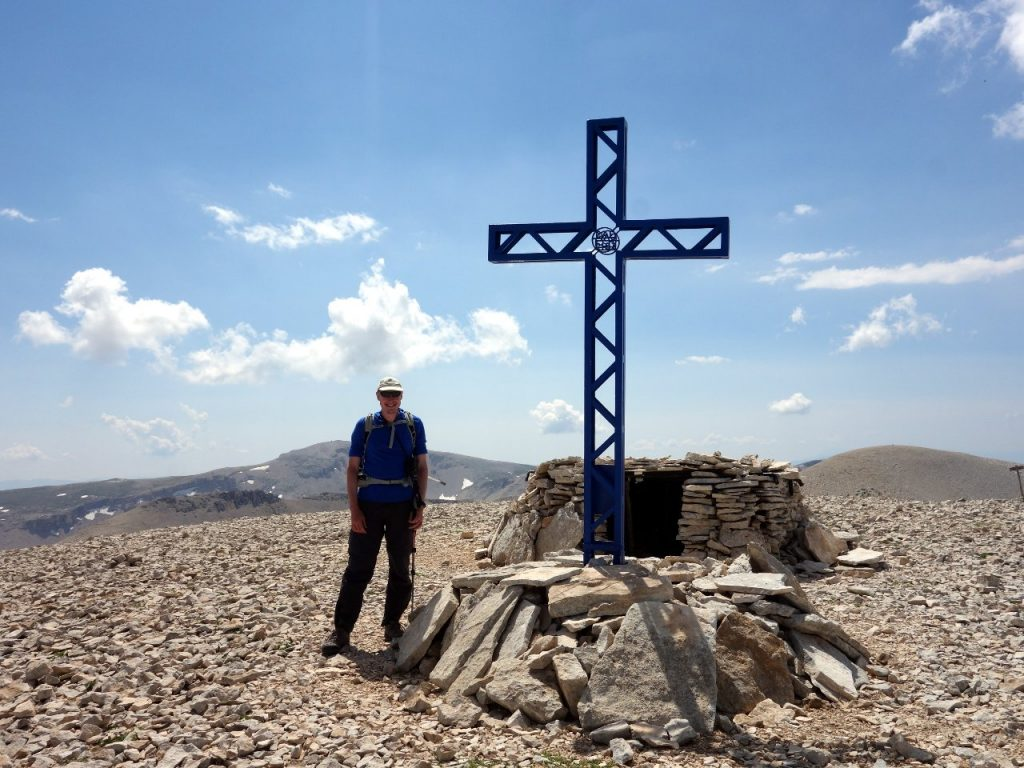 Beside Monte Acquaviva's giant summit cross and tiny summit shelter, with Monte Amaro behind