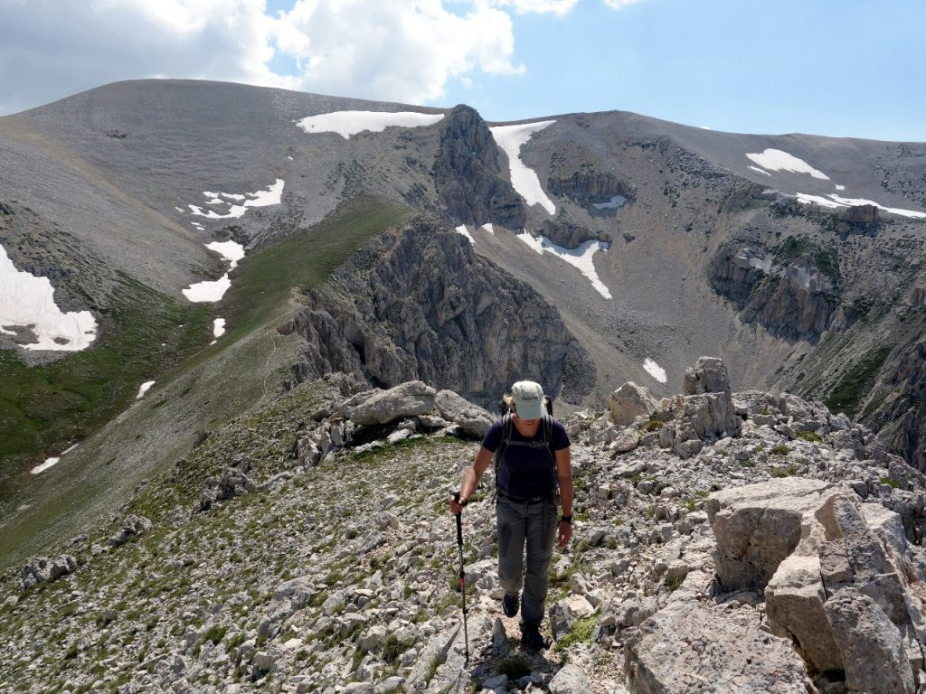 Edita on Cima delle Murelle's summit ridge, with the plateau behind