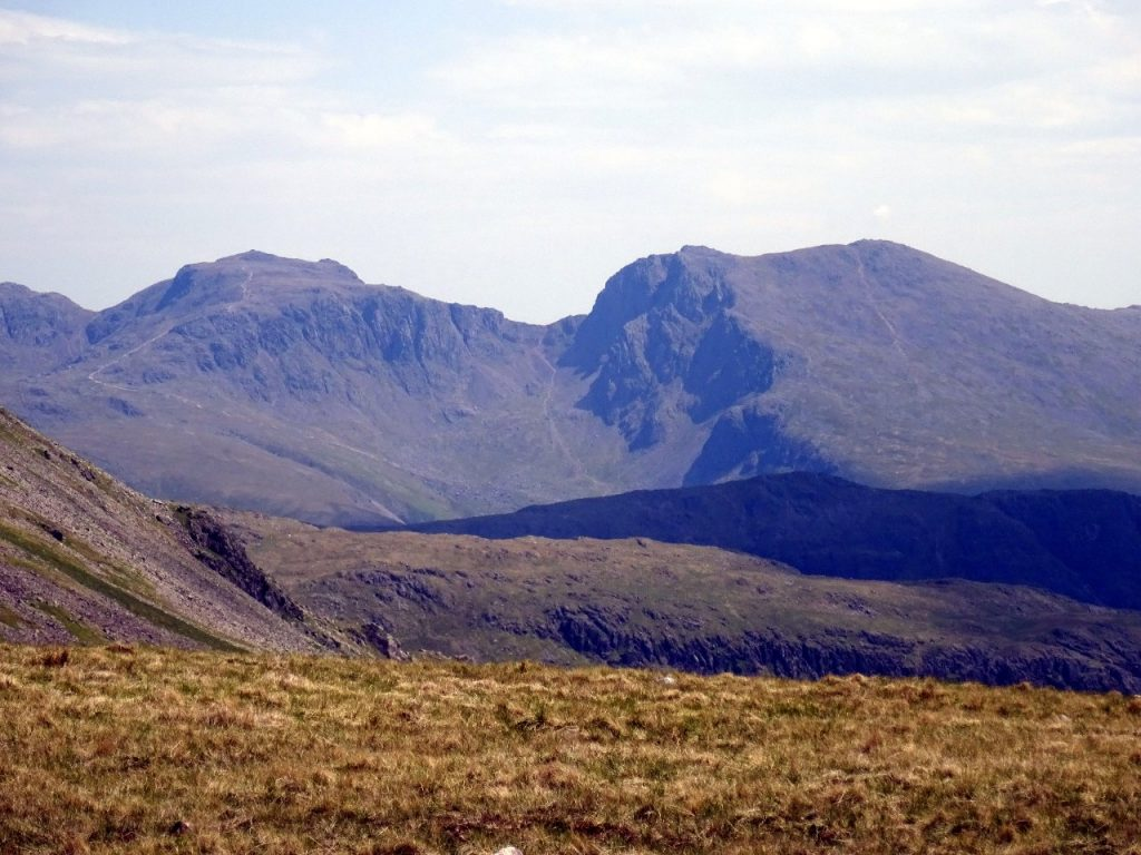 A last sight of the highest point in England (left): Scafell Pike and Sca Fell from Caw Fell