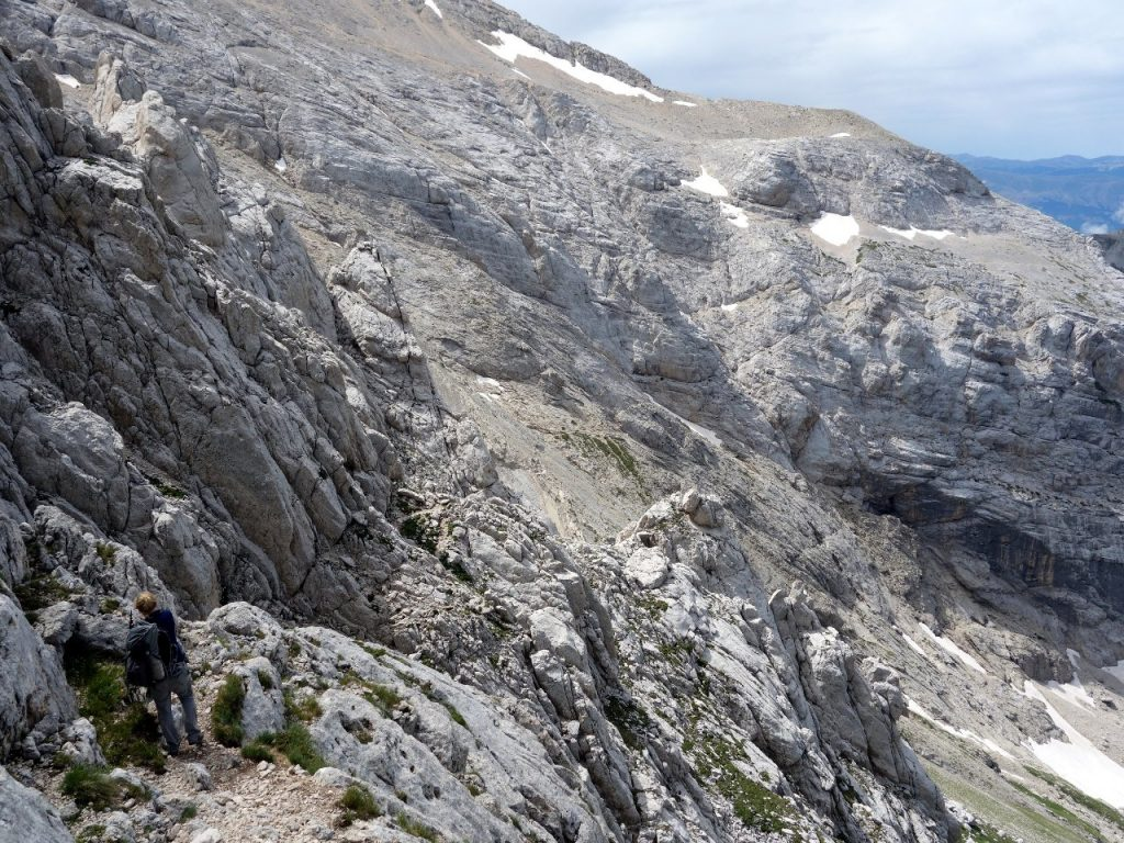 Descending from the via ferrati on Corno Piccolo, with via normale on Corno Grande on the shoulder of mountain across the couloir