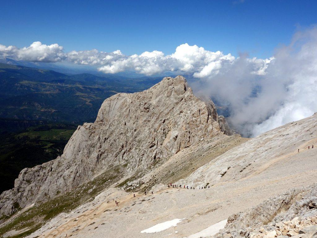 Corno Piccolo from the west ridge of Corno Grande, with figures descending via normale below. Corno dei Due Corni is the col to the right of Corno Piccolo.