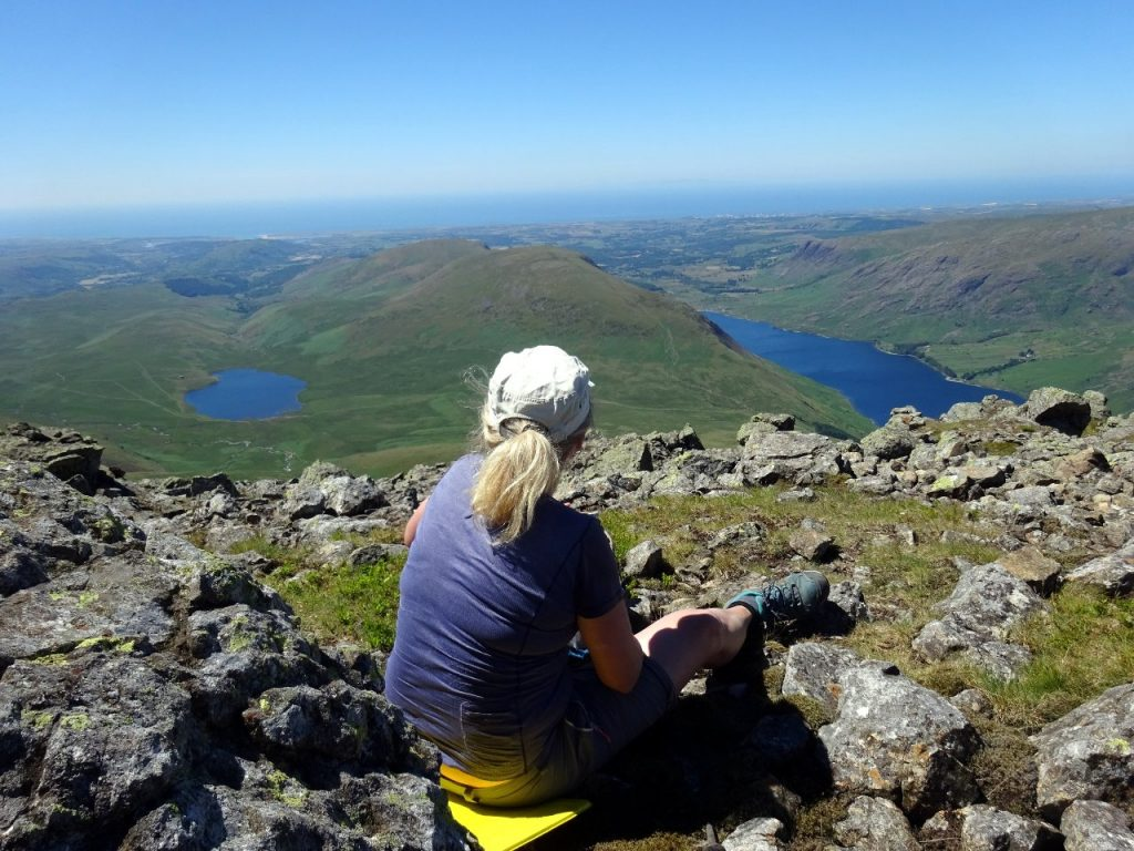 Looking towards the Irish Sea from the summit of Sca Fell, with Burnmoor Tarn and Wast Water down below