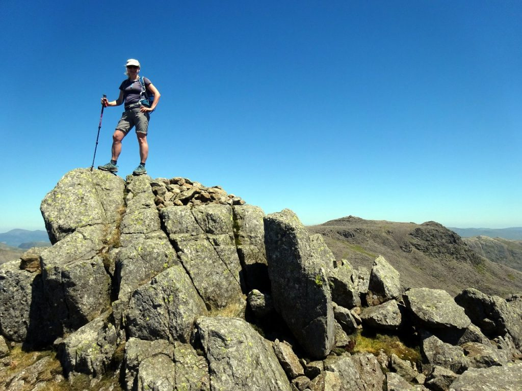 Edita on top of Symonds Knott, with Scafell Pike behind